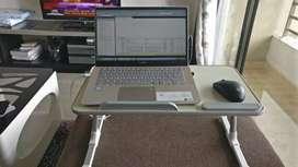 Adjustable laptop/study table