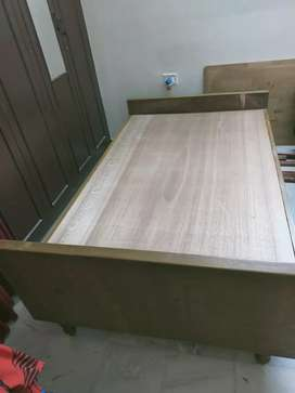 Two wooden double cots