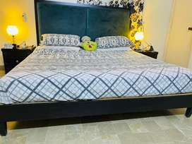 Bed with side table without mattress