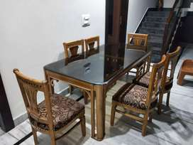 Dining table(Sagwaan wood) with 6 cushion chairs in superb condition