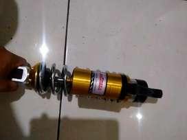 Shockbreker motor metic
