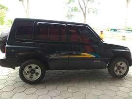 Suzuki Sidekick vitara escudo