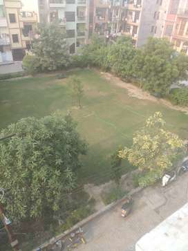 2 bhk flat top floor with roof right independent floor park facing