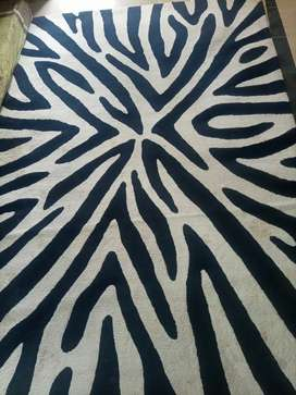 In a Blue n white color carpet in a good condition