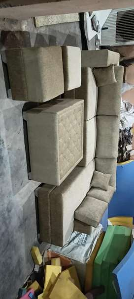 New L shape sofa set with table and 2 puffies.
