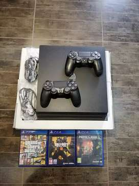 Ps4 pro | with 2 controllers including 3 games