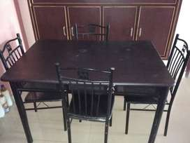 Black dining table with four chairs of Malaysian wood