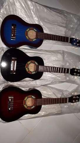 Gitar ukulele baru. Senar 4. Cocok untuk santai2 bersama teman-teman