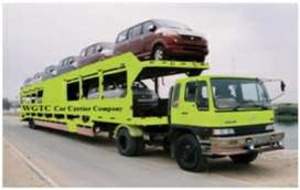 Low cost car carrier and door to door cargo delivery service