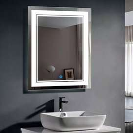 Mirror with touch sensor