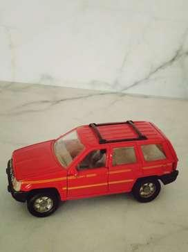 mainan mobil kijang merah