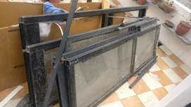 Aluminum panels with glasses old doors