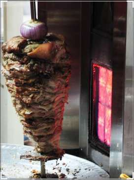 Assitant cook for shawarma