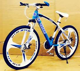 B. M 21 SHIMANO GEARS NEW BICYCLE