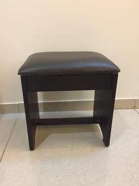 Dark brown wooden stool