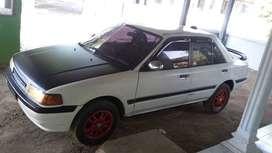 Mazda Interplay  sedan dgn fitur terbaik  Th 1990