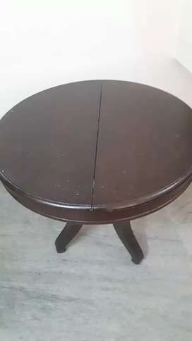 Antique round table with its homemade woolen cover
