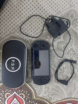 Sony black PSP with adapter, USB cable and cover