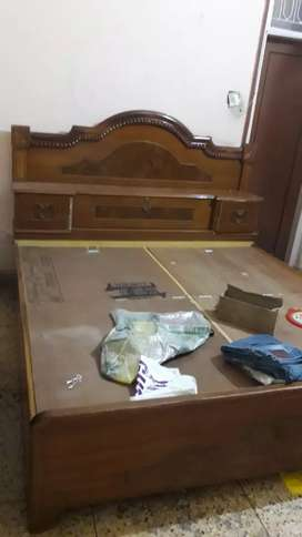 wooden bed made with teak wood