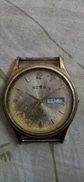 100 year old watch with 23k gold quartz star watch