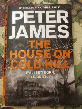 A book written by Peter James a book about a house on a cold hill