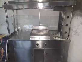 Counter with hard plate, shawarma Machine,fryer and 4 chair table set