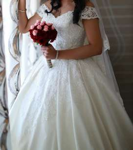 Elegant and luxurious Christian wedding white gown for sale or rent