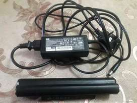 Charger and battery