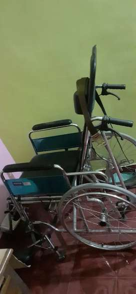 Wheel chair with two walking sticks  for sale