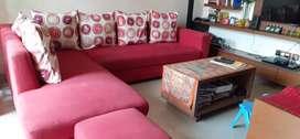 L shaped red sofa