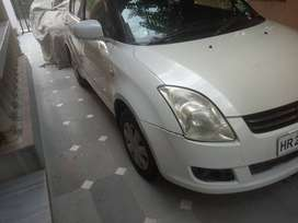 Very good condition DZire Vxi  variant pearl white colour.