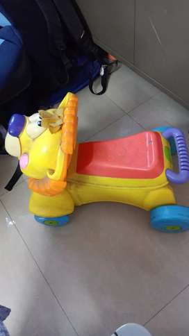 Fisher Price lion ride on and walker