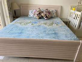 Bed with mattress and side tables