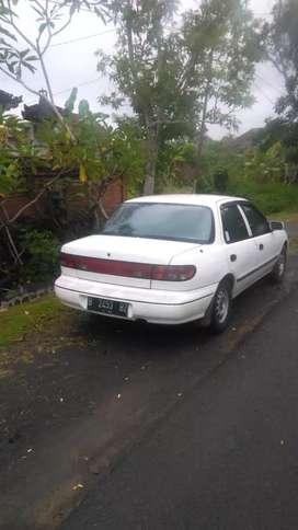 Timor 1997 warna putih plat B