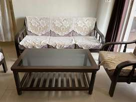 5 seater wooden Sofa set with glass table. Moving out sale.