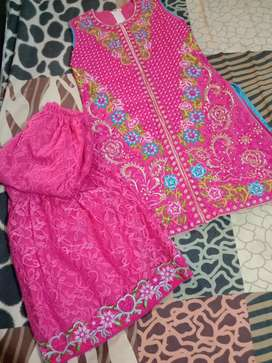 Girls dress pink in colour