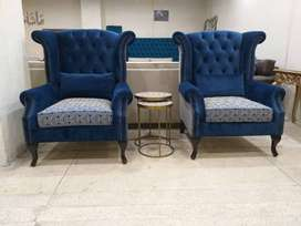 Pair of chesterfield wing chairs by furniture studio.