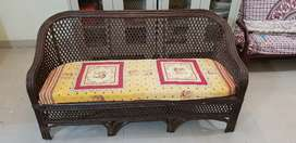 3.seater Cane Sofa as shown in the photo.