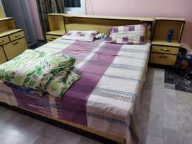 Bed with side tables and dressing