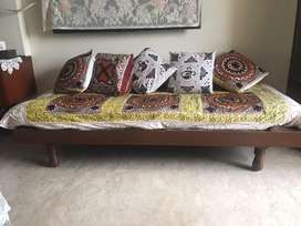 Wooden single bed with mattress