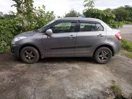 Updated Dzire fitted with alloy wheels, back camera and music system