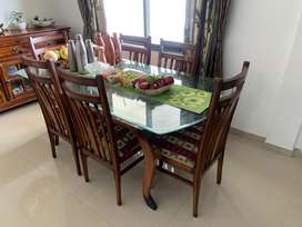 6 seater dining table set with glass top and matching central table