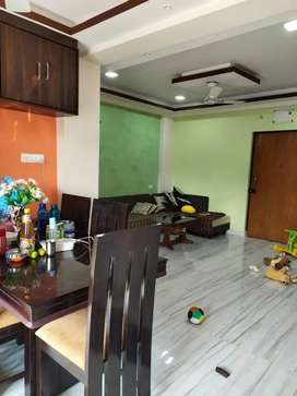 MIG 3bhk South-East Facing Semi-furnished, modular kitchen.