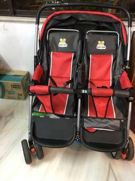 Baby's Black And Red Twin Stroller
