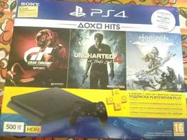 PS4 SLIM 500GB WITH GAMES LIKE SPIDERMAN, GOD OF WAR ETC