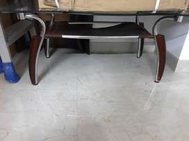 centre table with wooden panels in next to store condition