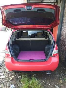 Mobil suzuki aerio plat temanggung atas nama sendiri