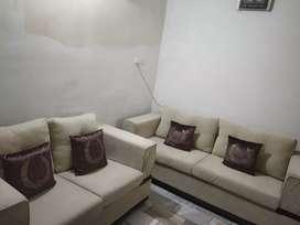 Sofa set with pillows.