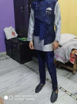 Grey kurta and navy blue pant with jacket grab it with black footwear
