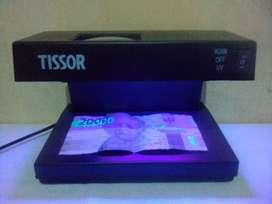 Alat Pendeteksi Uang Kertas Palsu Merek TISSOR T2078.
